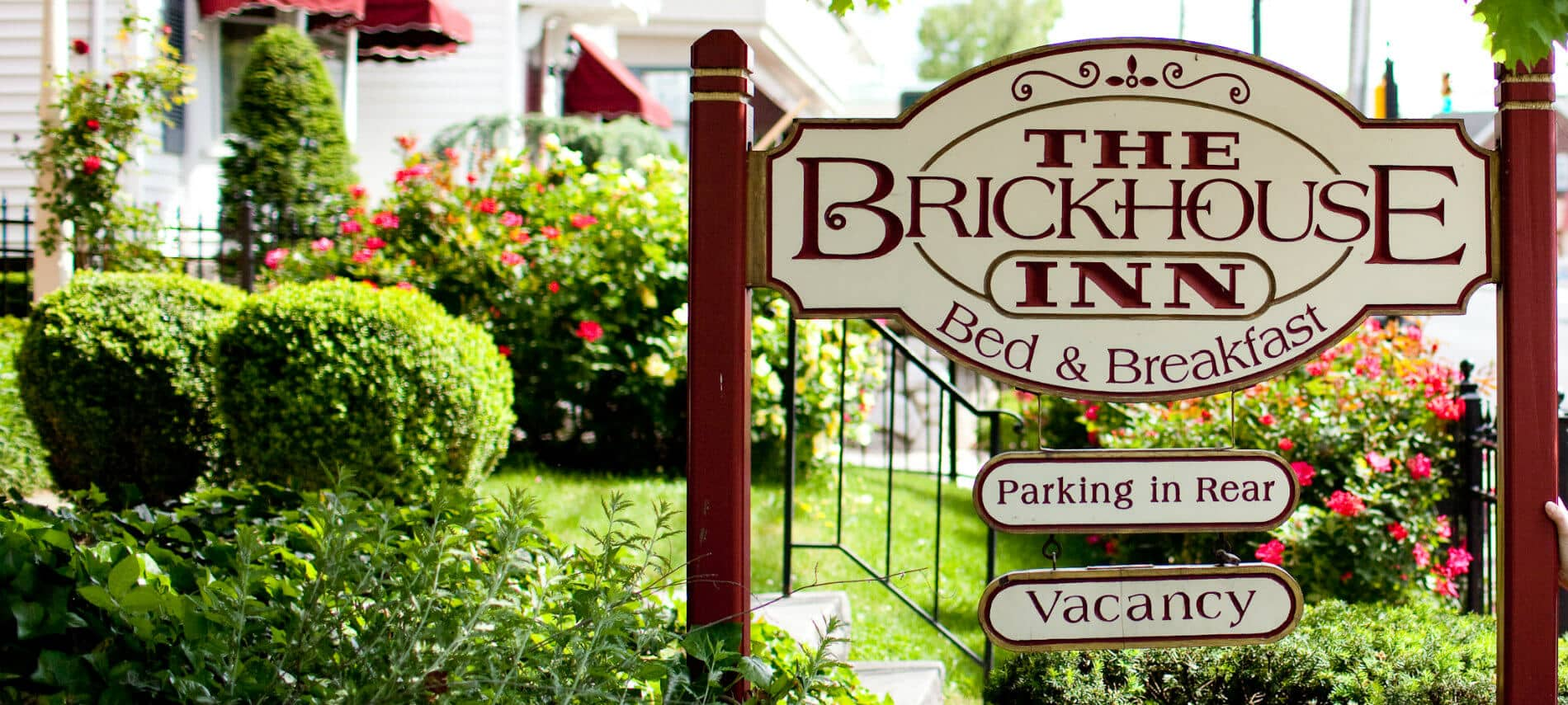 Exterior sign that reads: The Brickhouse Inn Bed & Breakfast, Parking in Rear, Vacancy