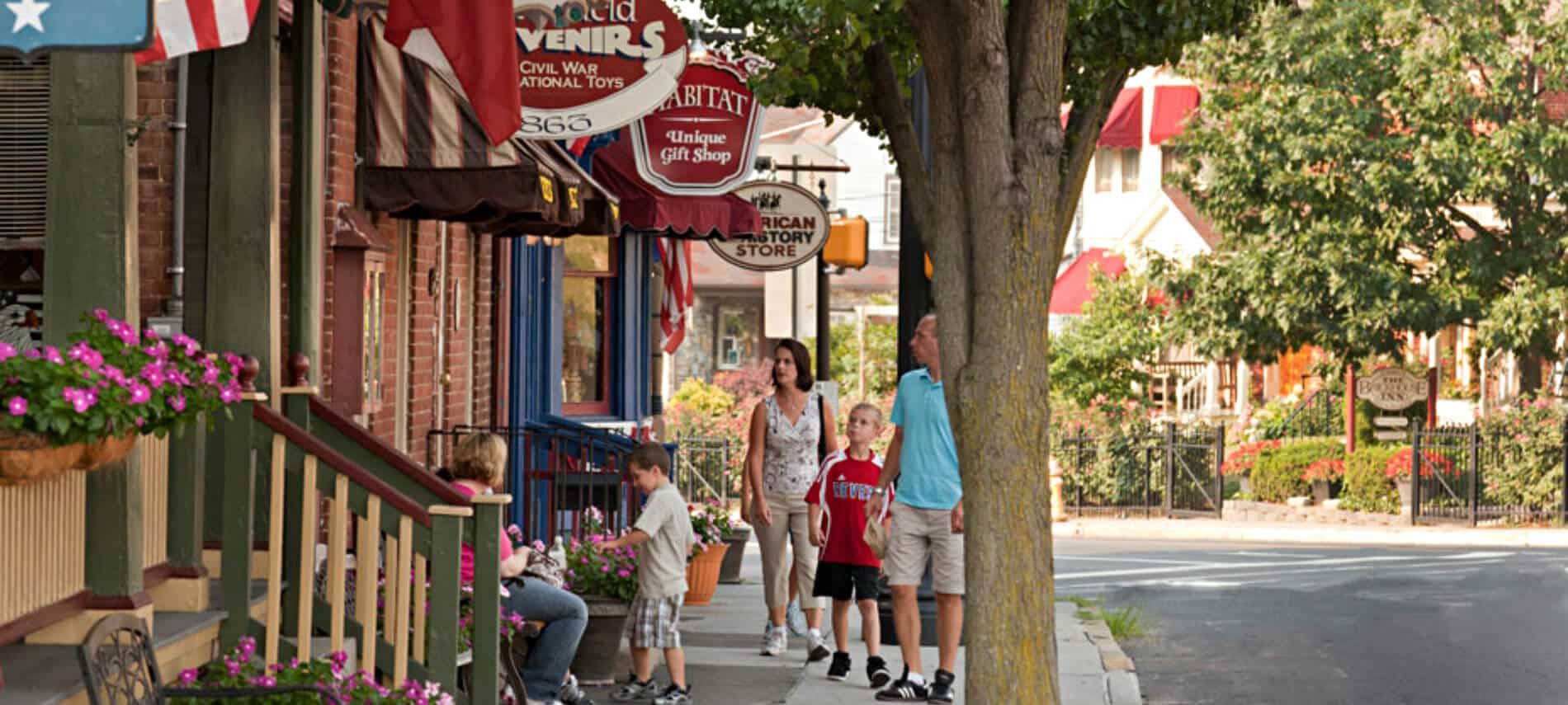 Downtown Gettysburg street lined with shops selling souvenirs, gifts, history, and more