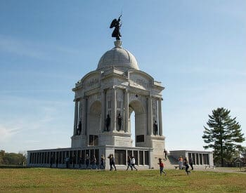 Large monument amidst spacious grounds and blue skies at the Gettysburg National Military Park