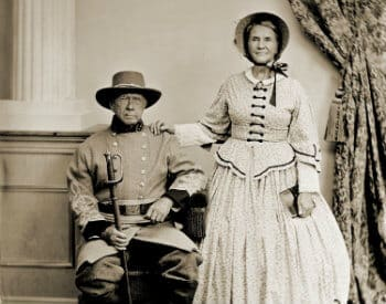 Old photograph from the 1800's of a husband dressed in a soldier's uniform, and his wife